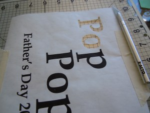 Cutting out the printed graphic on the freezer paper