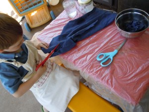 """Br cutting up an old T-Shirt into strips for the """"mache"""" bowl"""