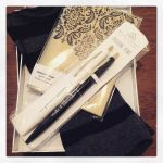 Photo of the Day: Writerly gifts for day 4 of #12daysswap – positive pens, a gold notebook, and hand warmers for my garret!