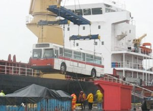 A trolley being hoisted into the cargo hold of a ship bound for South America.