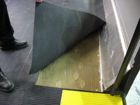 The plywood flooring on a bus