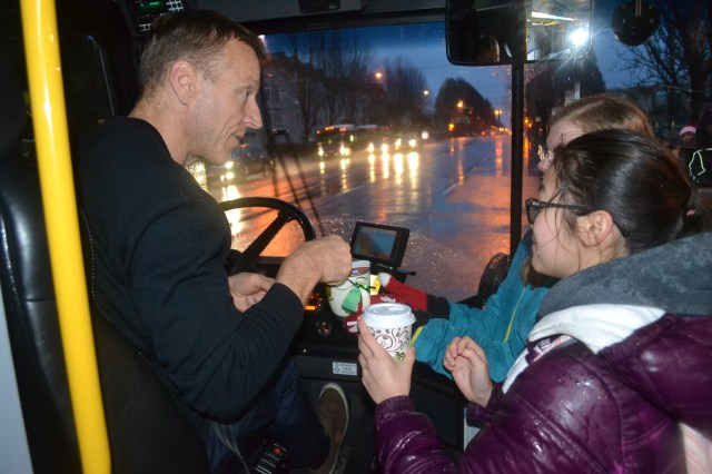 One of our operators receive a hot chocolate and a hug with holiday treats from Van Tech students