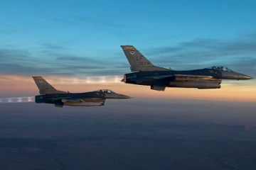 U.S. F-16 fighter jets escort a plane back to Canada due to a bomb threat