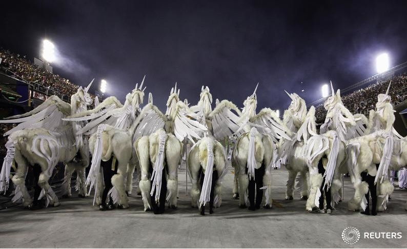 Revellers in unicorn costumes from the Grande Rio samba school participate in the second night of the annual Carnival parade in Rio de Janeiro's Sambadrome February 21, 2012. REUTERS/Nacho Doce