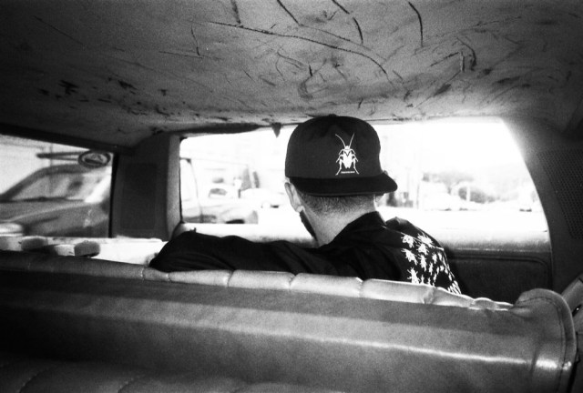 Matt Evans admiring the streets of San Francisco from the boot of Dela's car.