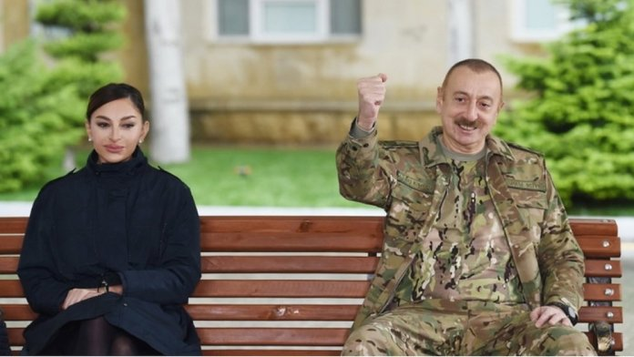 Azerbaijan President Ilham Aliyev (R) and first lady Mehriban Aliyeva (L) meeting with servicemen undergoing treatment