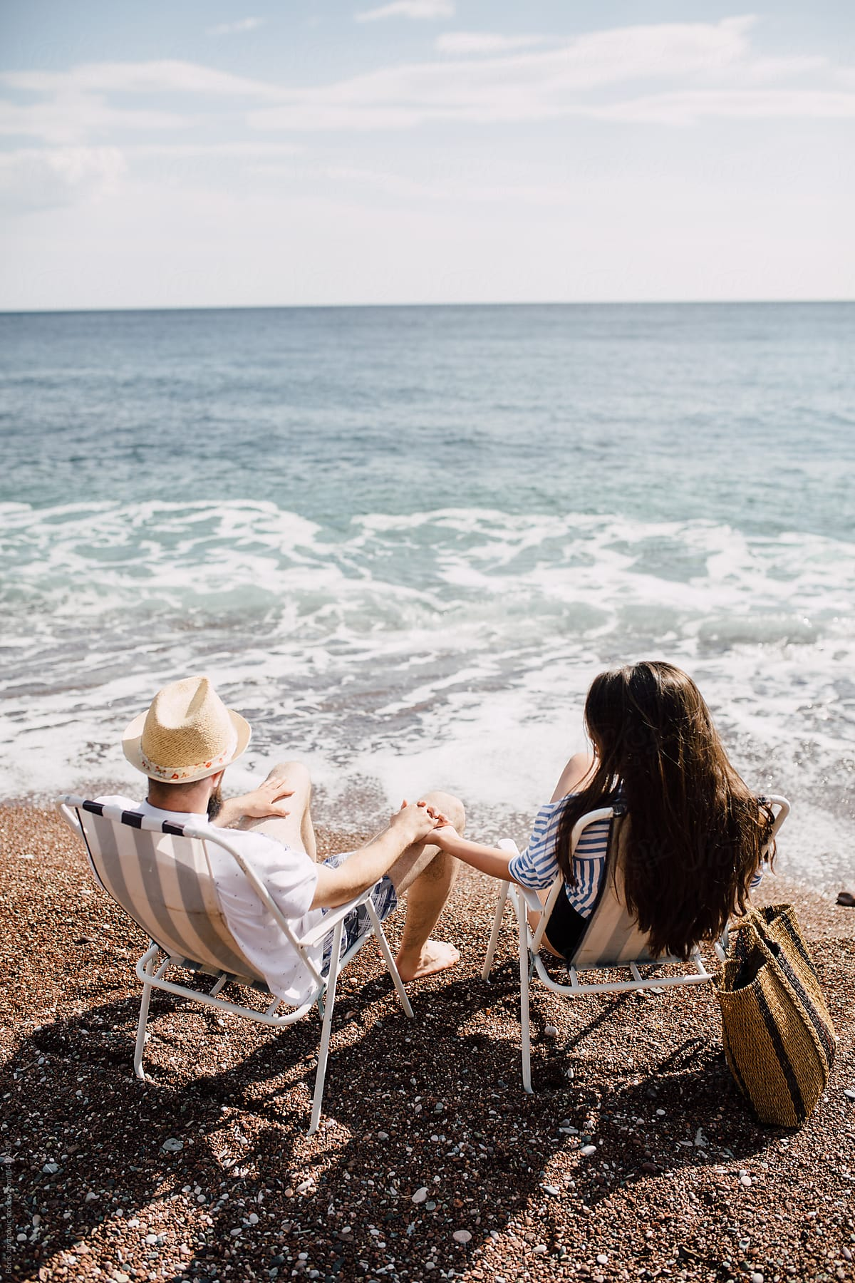 Couple Sitting On Beach Chairs Holding Hands By Boris Jovanovic Beach Couple