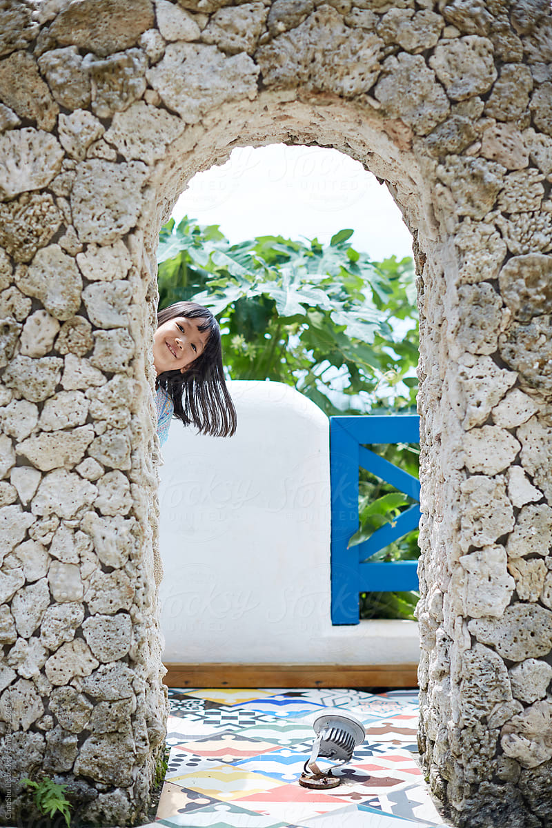Hide And Seek Kids Stock Photo Hide And Seek Children Hiding Behind The Natural Coral Stone Arches