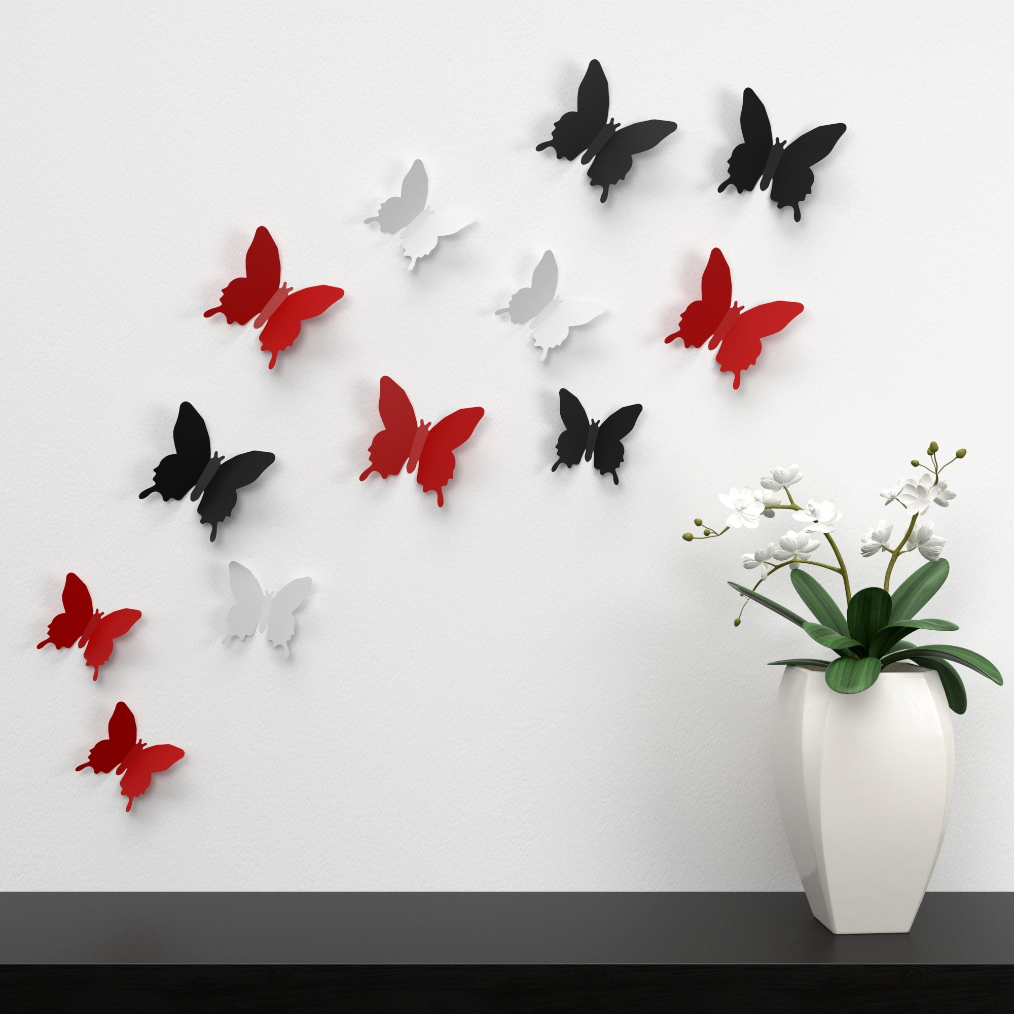 white, black, and red butterflies wall decor near white