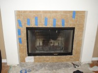 Almost done replacing the tile around the fireplace | Flickr
