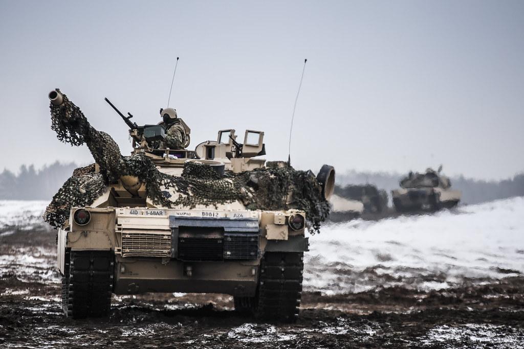 Wallpaper Sakura 3d A Convoy Of M1 Abrams Main Battle Tanks Move Through Open