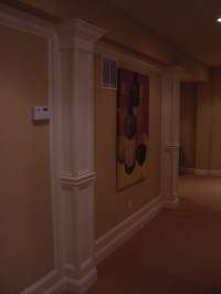 custom half columns and paneled walls
