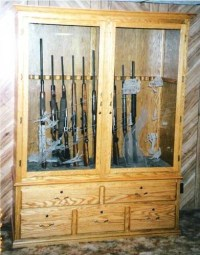 Custom built gun cabinet | Design, glass labor, $300 | Flickr