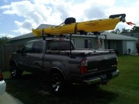 A Heavy Duty Truck Bed Cover And Kayak Rack On A Toyota Tu ...