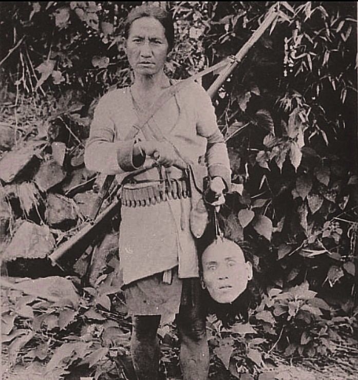 Atayal Head Hunter with head NAA 04542600 - ca 1900 Flickr