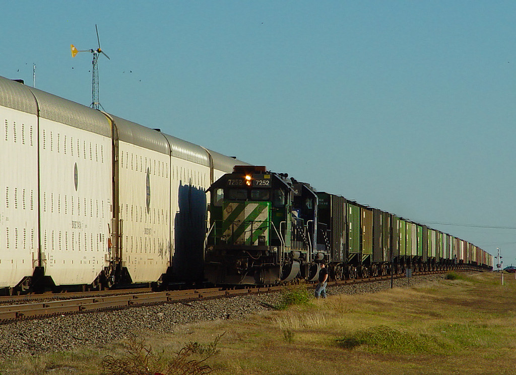 Conductor Roll-by; Norman, OK The conductor of a grain tra\u2026 Flickr