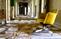 yellow chair | an old yellow office chair sits forgotten ...