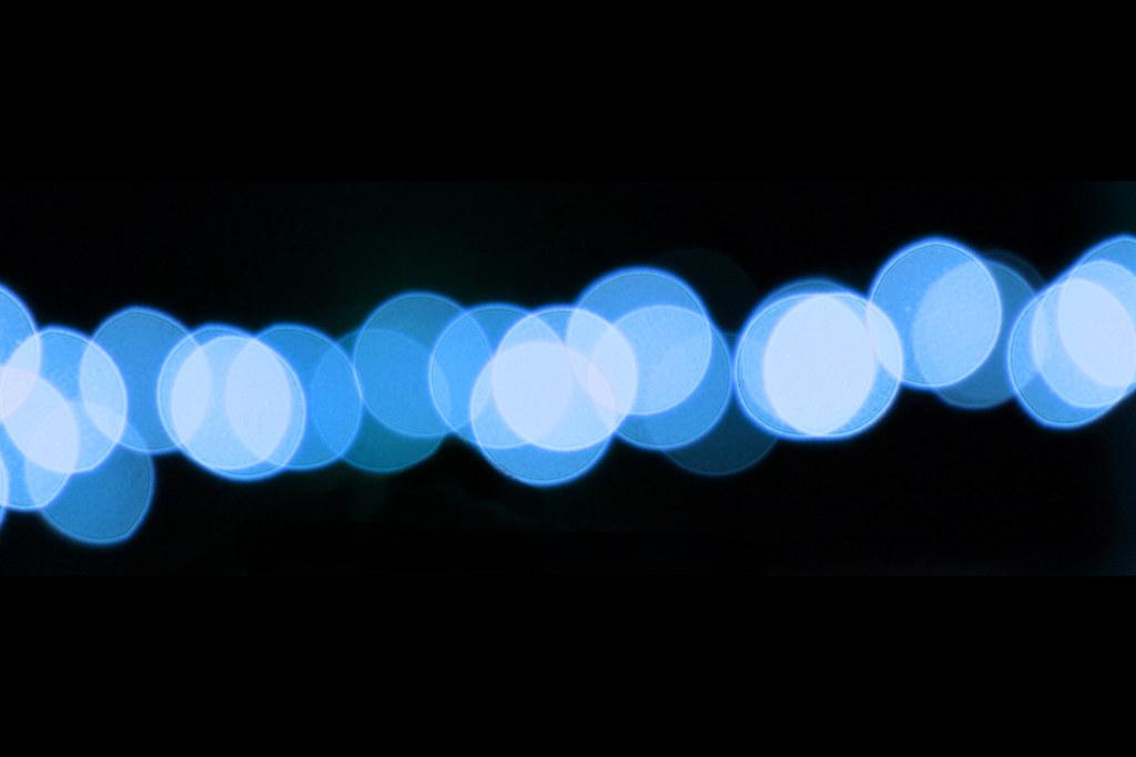 Blue Bokeh on Black Background Blue out-of-focus lights cr\u2026 Flickr