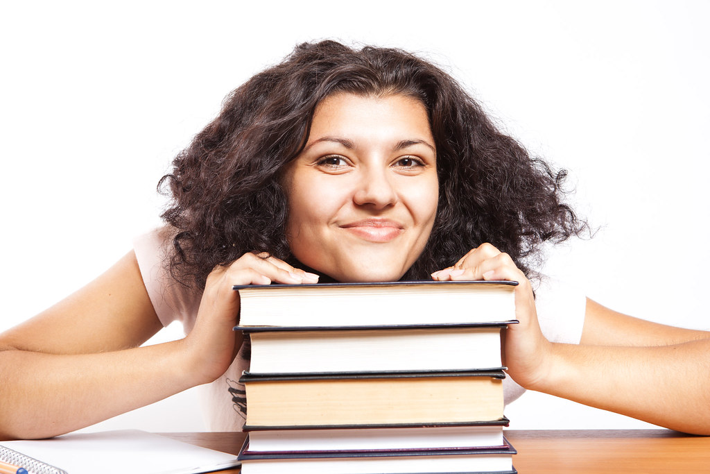 Student A university student with her head on her books gi\u2026 Flickr - student