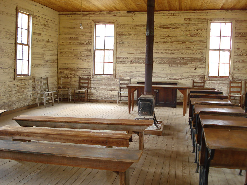 inside of old schoolhouse with wood stove