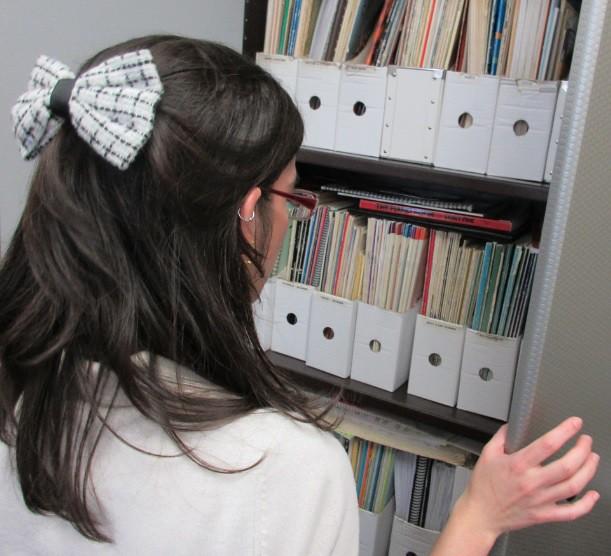 music school teacher looks at lesson books