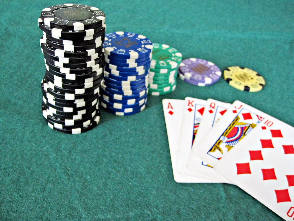 3d Money Wallpaper Poker Hand And Chips A Winning Poker Hand With A Pile Of