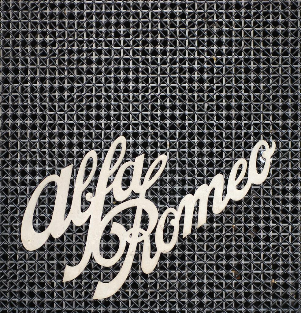 3d World Wallpaper World Alfa Romeo Logo Alfa Romeo Logo Mounted On The Grill Of