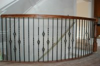 curved rail | Curved balcony railing with iron balusters ...