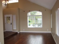 Formal living room with vaulted ceiling and sunken living ...