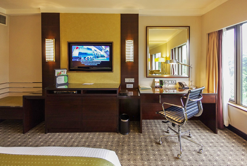 tv and work desk - club room of holiday inn singapore orchard city centre