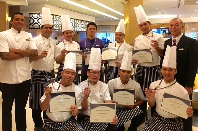 Quest Hotel Cebu team with their CGC medals and awards flanked by new executive chef Dinesh Sampath and new F&B manager Ronald Yulo