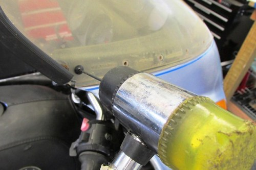 Drill Bit and Hammer Removing Center Pin of Windscreen Rivet