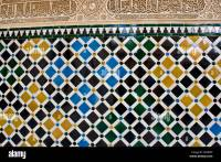 Intricate stucco Islamic artwork and repetitive tile ...