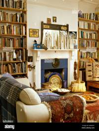 Tall bookshelves on either side of fireplace in ethnic ...