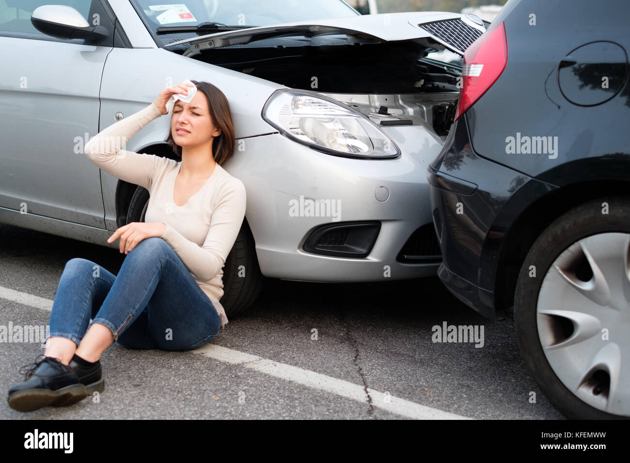 Injured In Accident Injured Girl After Car Accident In The Street Stock Photo