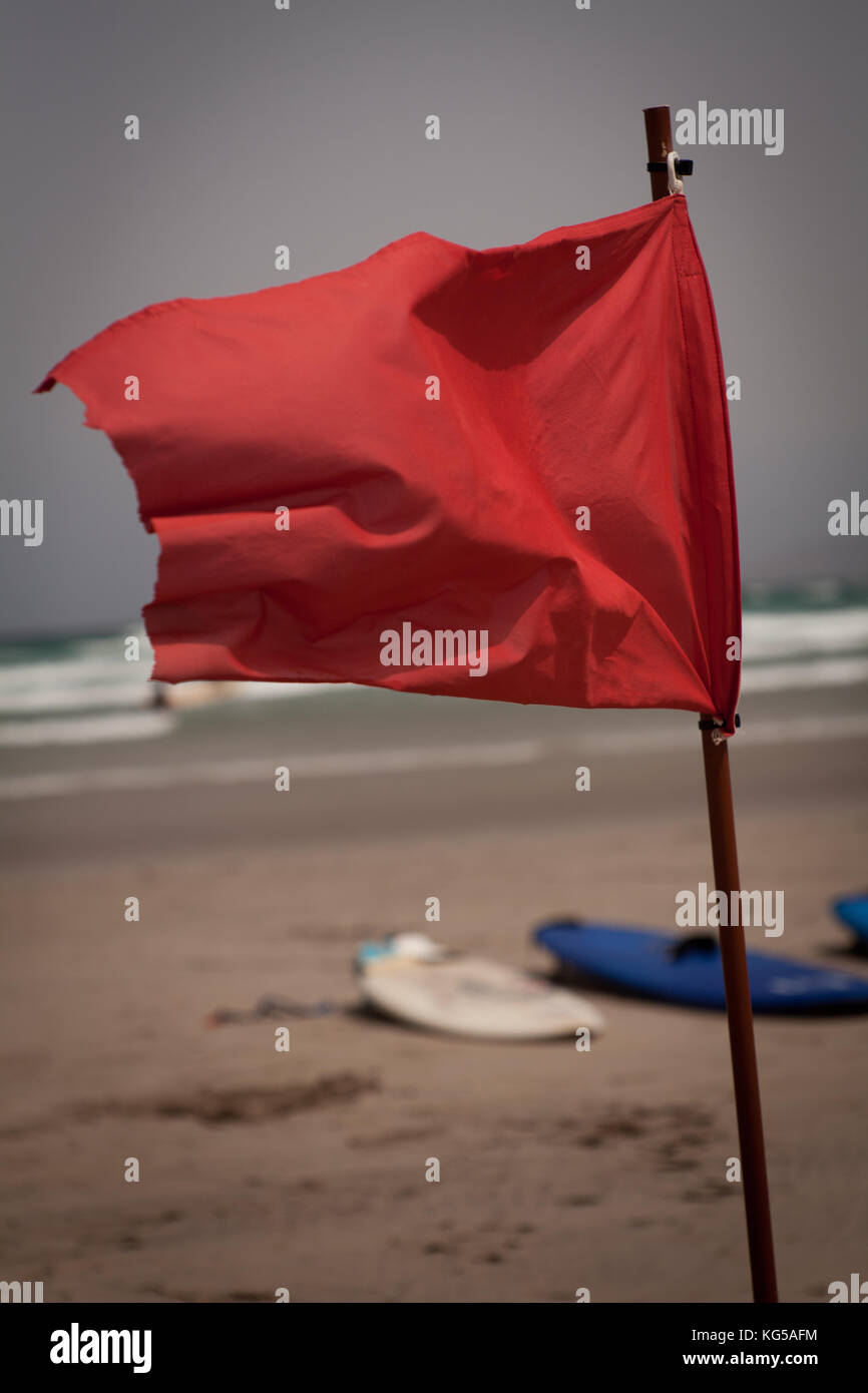 Flapon Red Flag Flap On The Beach Surfboards In Background Stock Photo