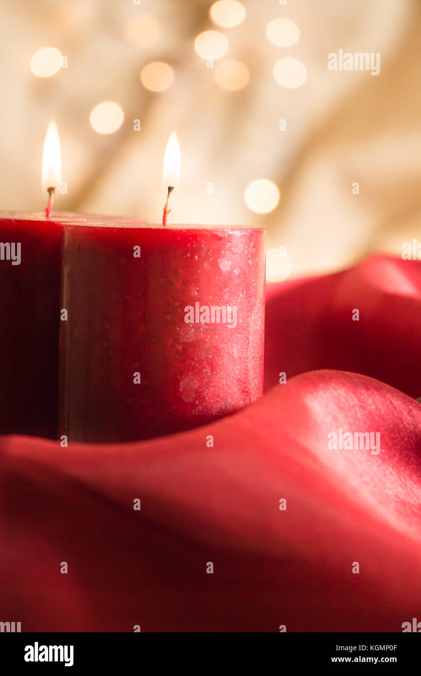 Lit Fabric Lit Red Candles On Red Wavy Fabric And Golden Background With