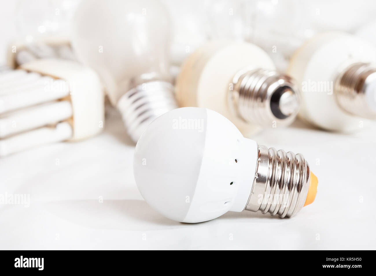 Led Verlichting 50 Lampjes Energy Saving Led Lamp And Several Old Light Bulbs Stock Photo