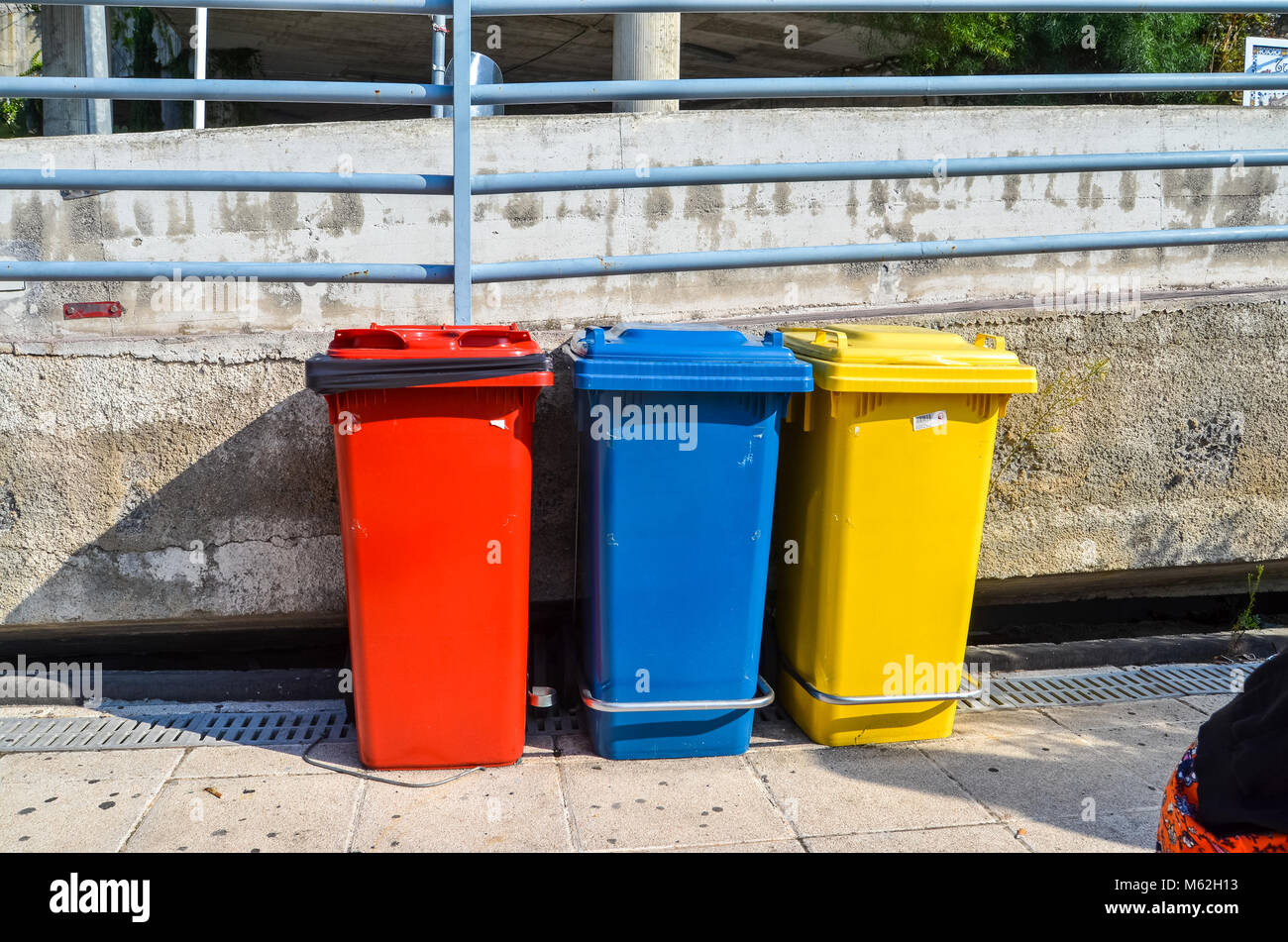colourful signs for recycling bins