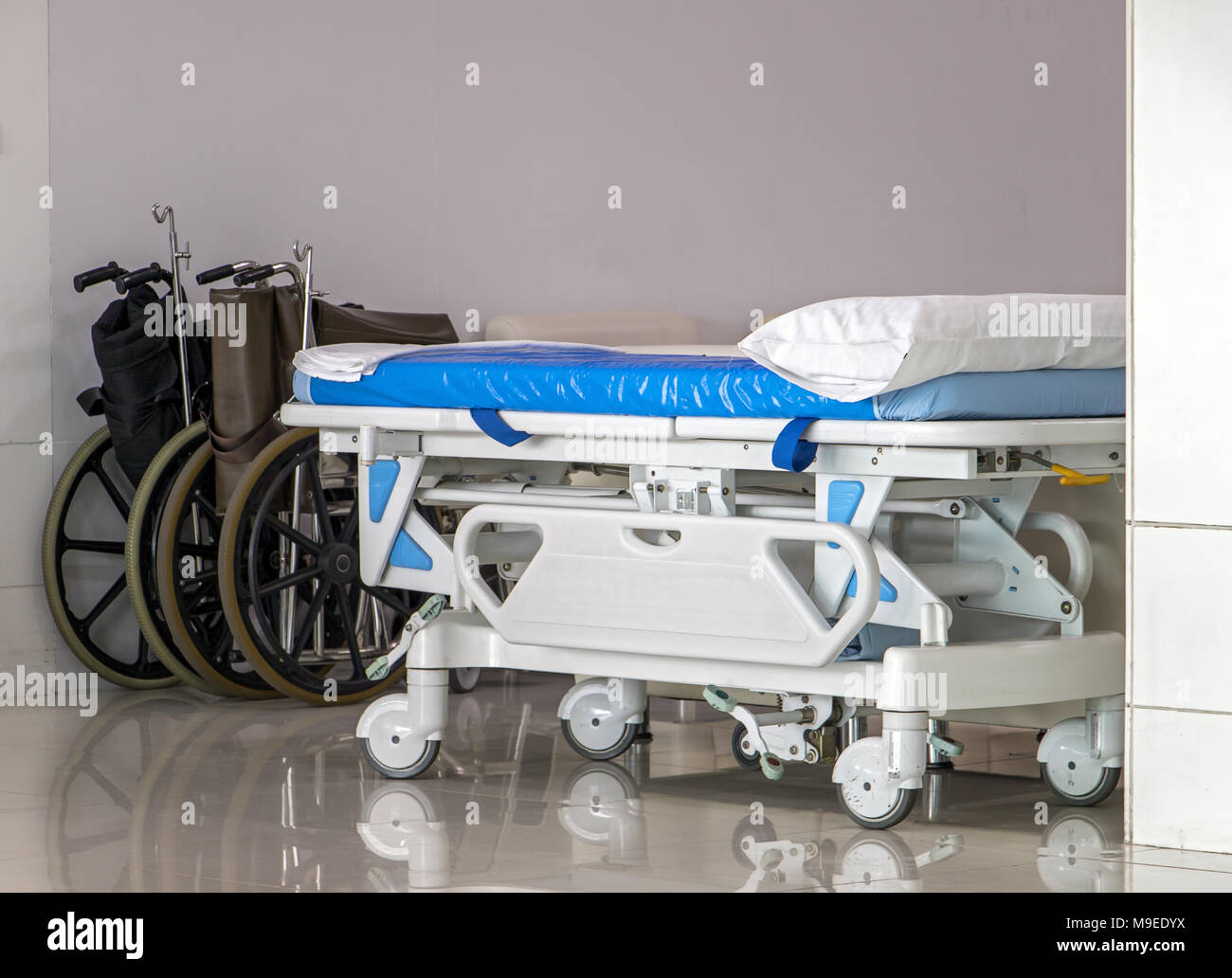 Bed Wheelchair A Empty Wheelchair And Wheel Bed For Patient At Hallway Of