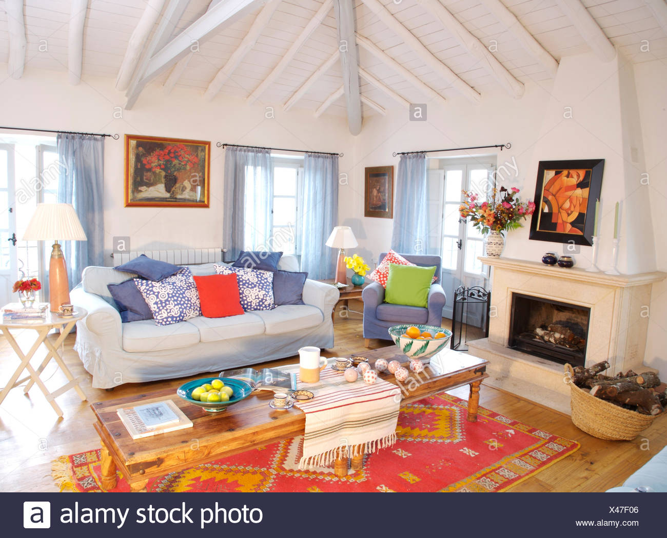 What Is Sofa In Spanish Colorful Cushions On White Sofa In Spanish Country Living Room