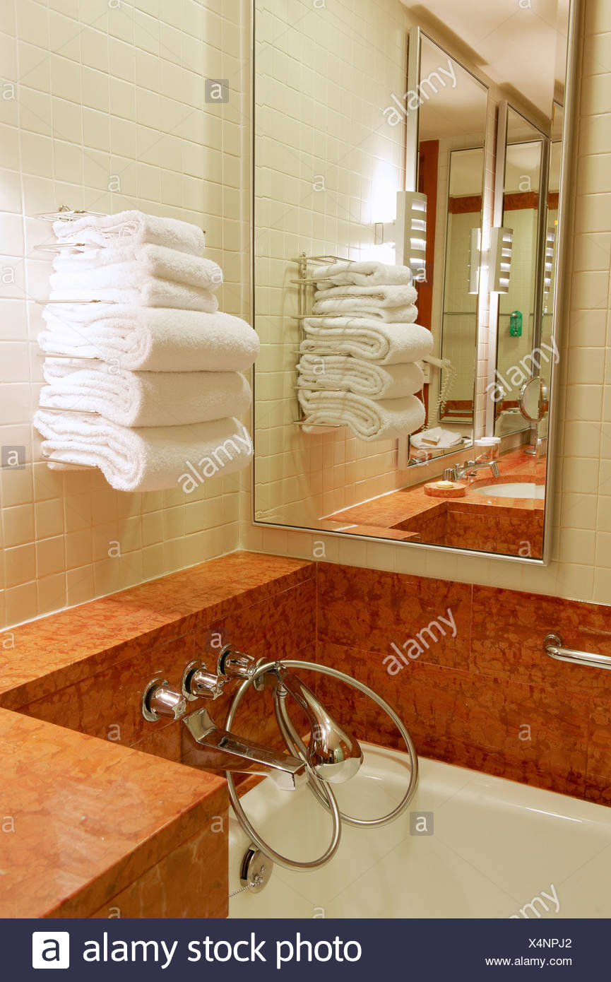 Bathroom Corner Mirror A Bathroom Corner With A Rach Full Of Clean Towels A Mirror And A