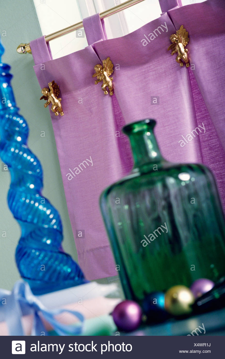 Cafe Curtain Clips Close Up Of Green Glass Bottle And Blue Spiral Bottle In Front Of