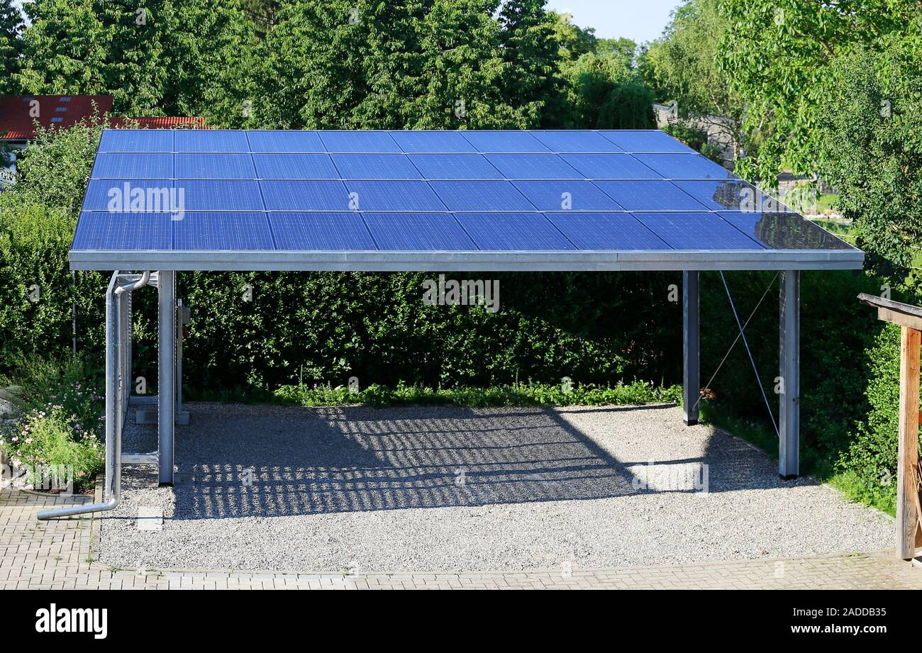 Karpot New Carport With Semi Transparent Photovoltaik Moduls Stock Photo - Alamy