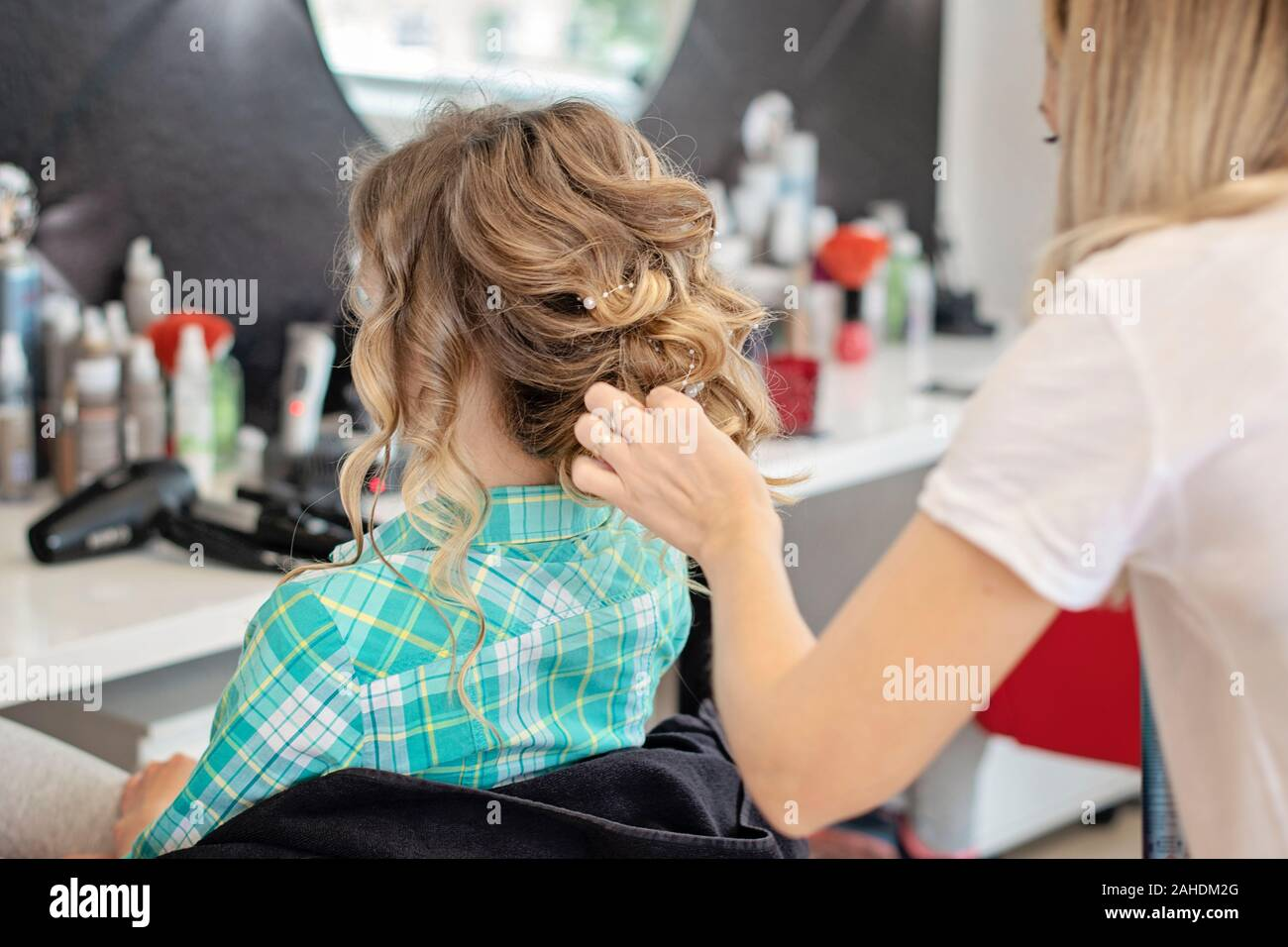 Beautiful Curly Special Occasion Hairstyle Hairdresser Makes Hairstyle Young Blonde Hair Lady In Barber Salon Stock Photo Alamy