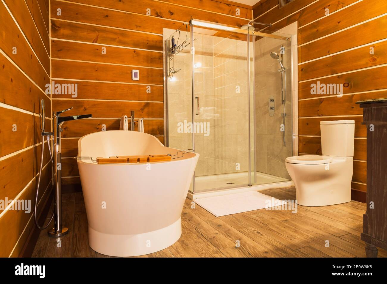 Interior View Of Bathroom With Freestanding Tub And Wood Cladding On Walls And Floor In A Log Home Stock Photo Alamy