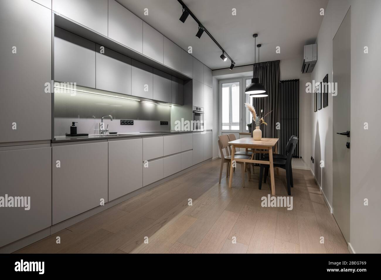 Interior Of Illuminated Modern Kitchen With White Walls Stock Photo Alamy