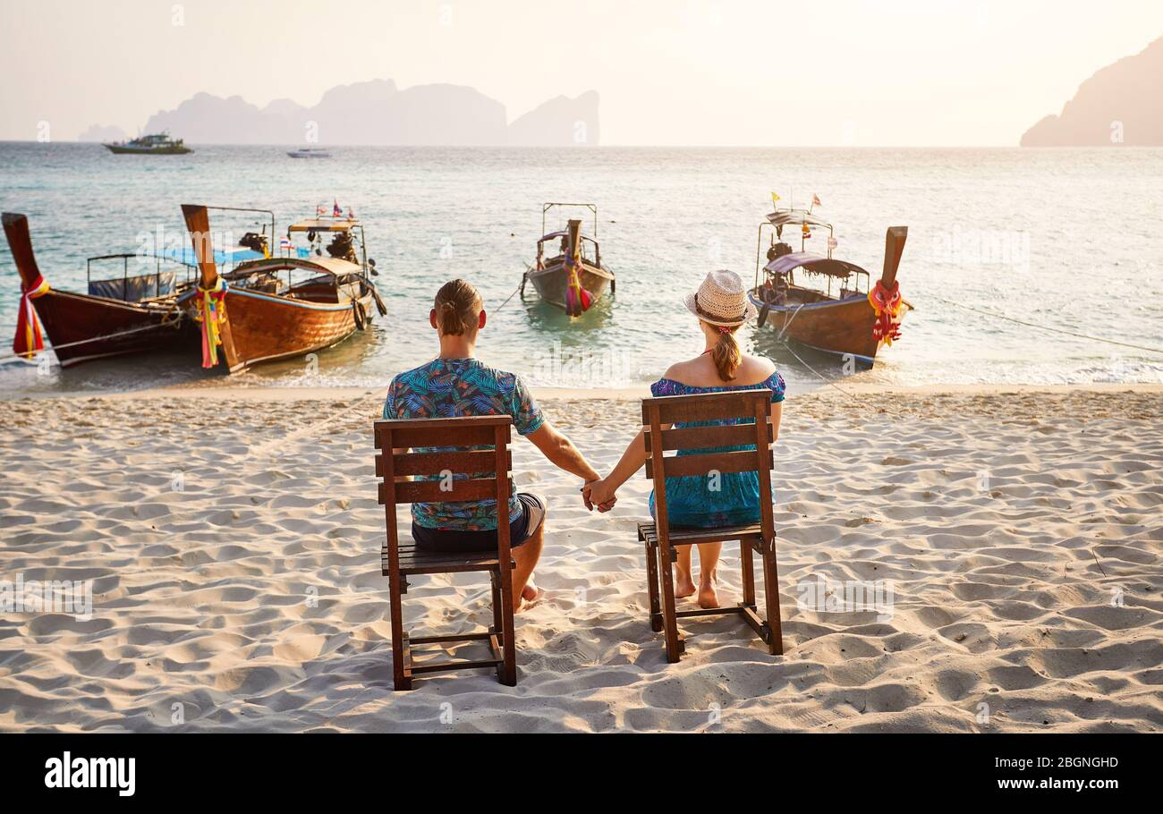 Young Couple Sitting On The Chairs On The Tropical Beach Of Phi Phi Island In Southern Thailand Travel Magazine Concept Stock Photo Alamy
