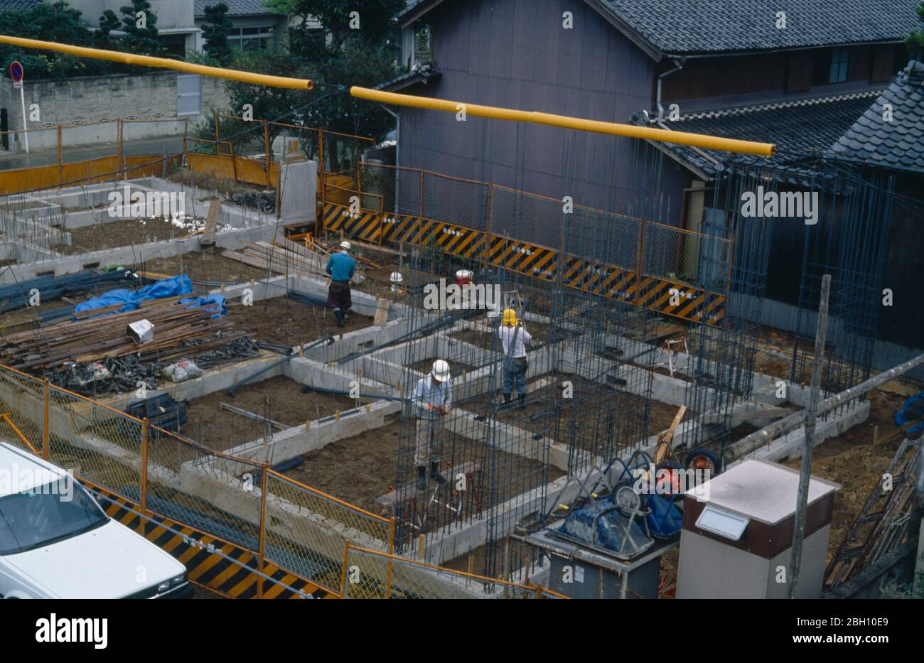 Japan Honshu General Men Working On Construction Of Building Foundations Stock Photo Alamy