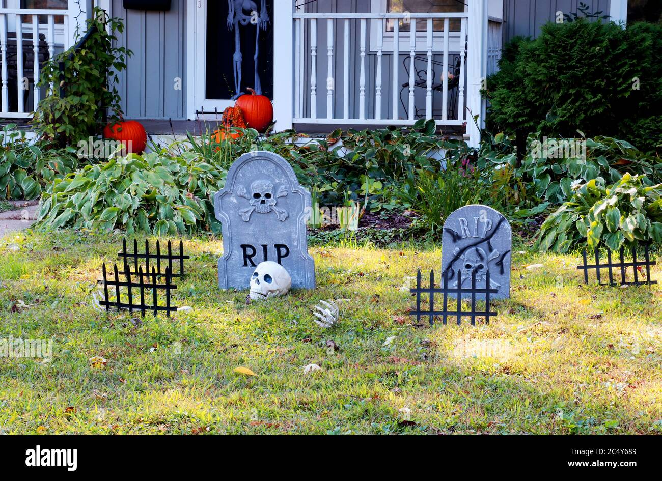 Front Yard Of Private House Decorated By Fake Skull Bones Hands Tombstones And Grates Pumpkins On The Porch For A Old American Trick Or Treat Hallo Stock Photo Alamy